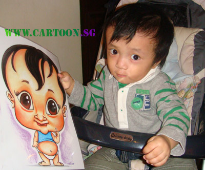 Baby holding up a caricature of himself done in exaggerated style by mommy.