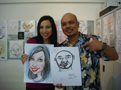 Elizabeth Tan the caricature artist for a day. That drawing of me will definitely go on the wall.