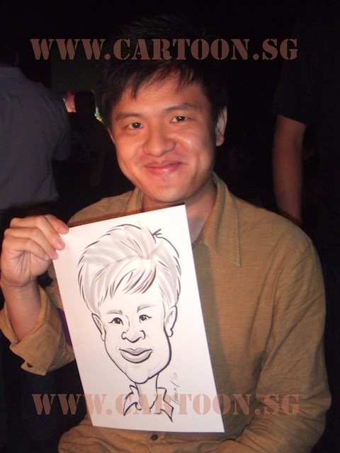 Guy holding caricature of himself