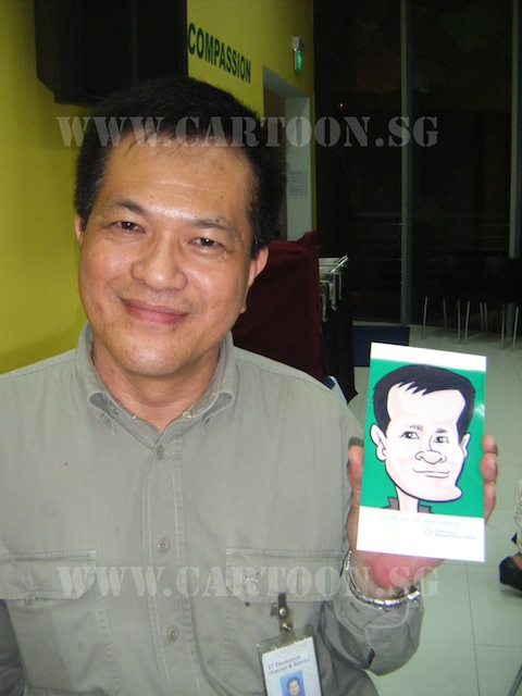 Guy happily showing off his digital caricature