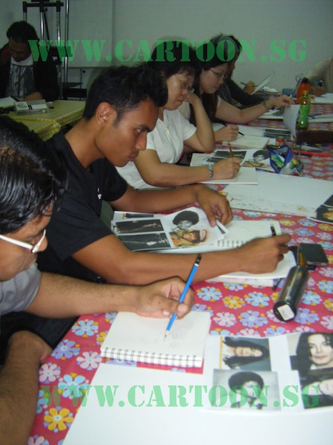 Caricature students concentrating on a subject matter to get likeness