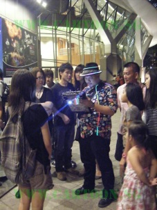 Our caricature artist being surrounded by curious public at Esplanade