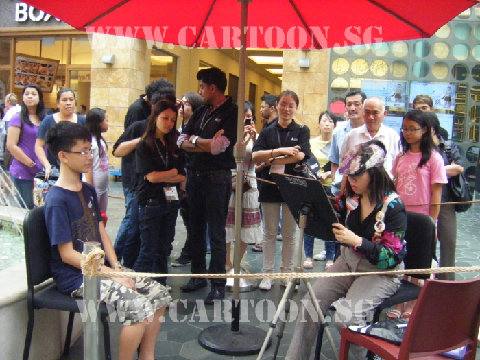 Caricature artist at work at Resort World Sentosa