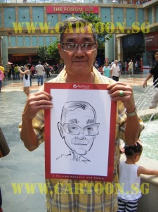 Resort Wolrd visitor gets drawn live caricature
