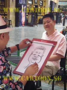 caricature artist drawing at resort world sentosa