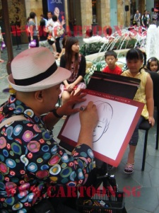 Caricature artist at work @ Resort World Sentosa