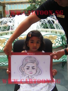 Shy indian girl posing with a caricature of herself