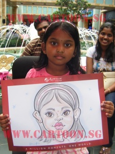 Indian girl posing with her caricature