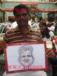 Delighted tourist posing with a caricature done by our caricaturist