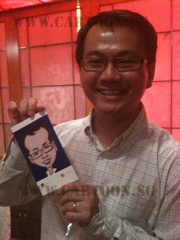 Smilling Guy showing off his digital caricature