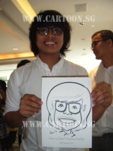 Happy Guest holding his caricature done by Cartoon.sg